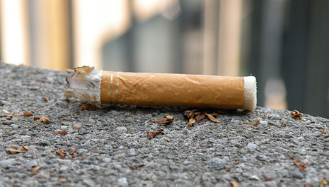 Cigarette_on_asphalt